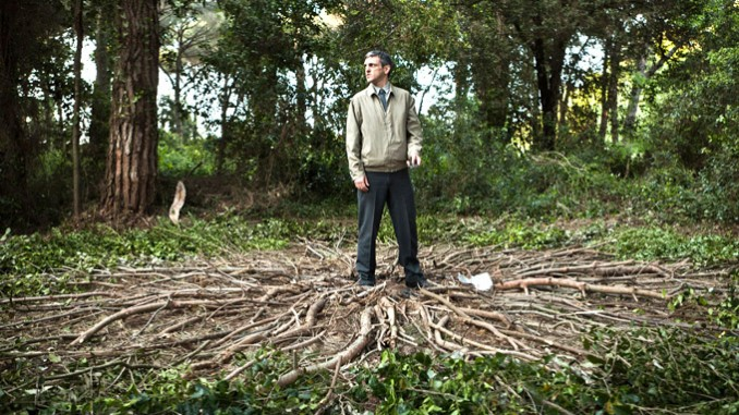 Gabriele Spinelli contemplates the evidence of visitors in The Last Man on Earth